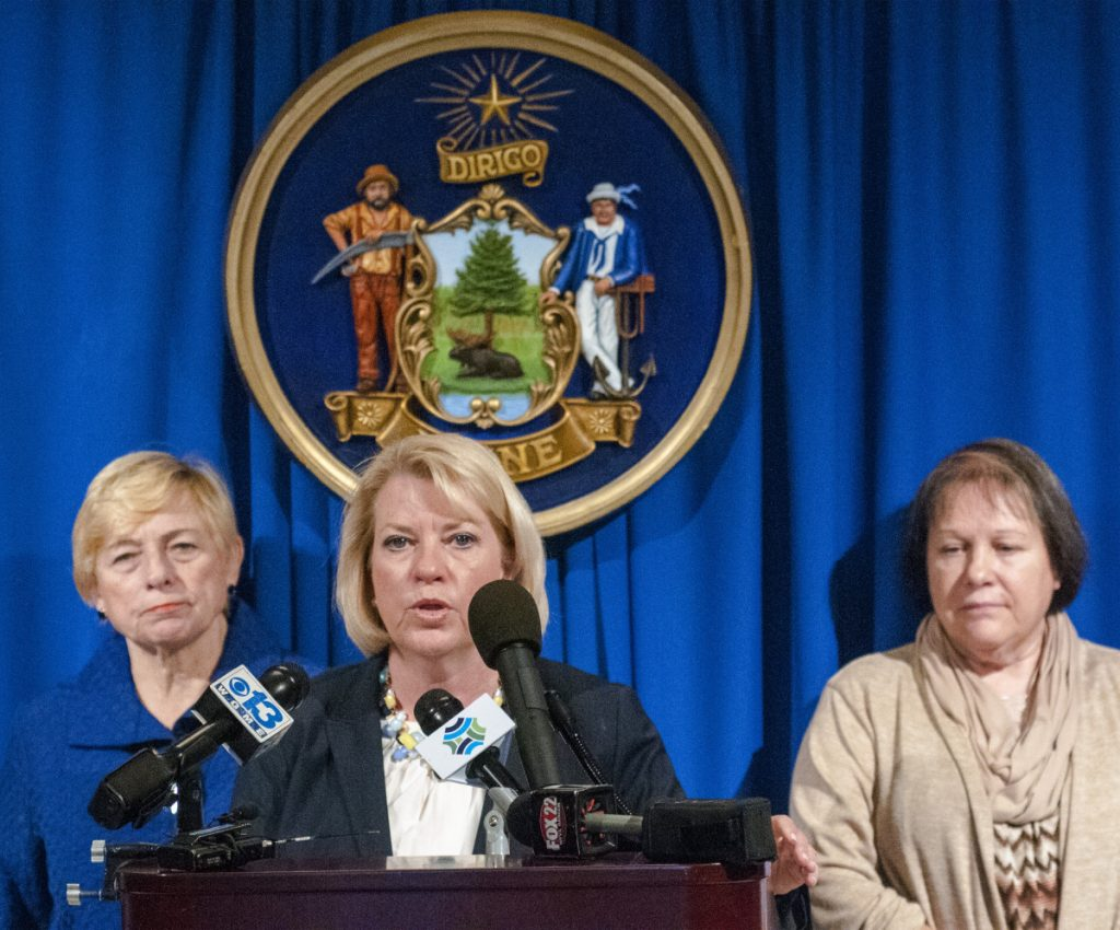 Deputy Attorney General Lisa Marchese, center, speaks during news conference on Tuesday in The Hall of Flags of the Maine State House in Augusta. Attorney General Janet Mills, left, and Barbara Theriault, mother of the late Amy Theriault, also spoke at the event.