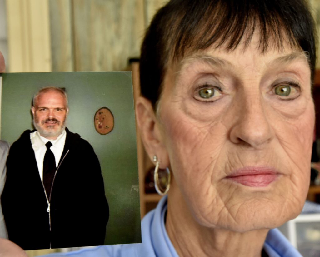 """Shirley Kershner holds a photograph of her son Anthony, 46, while speaking about his suicide in Waterville. She said she is heartbroken by the death and acknowledged he suffered from mental illness and said, """"He was a good person."""""""