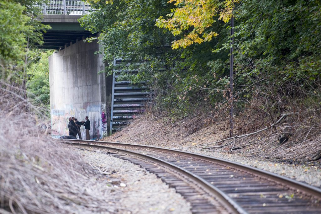 Investigators with the Maine State Police and Waterville police investigate the scene where a man was found dead under the overpass of the railroad tracks at North Street. Authorities later identified the man as Anthony Kershner, 46, of Waterville.