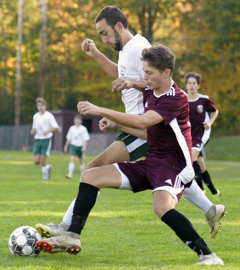 Monmouth's Corey Armstrong, right, tries to get past Winthrop's Jared McLaughlin during a Mountain Valley Conference soccer game Tuesday in Monmouth.