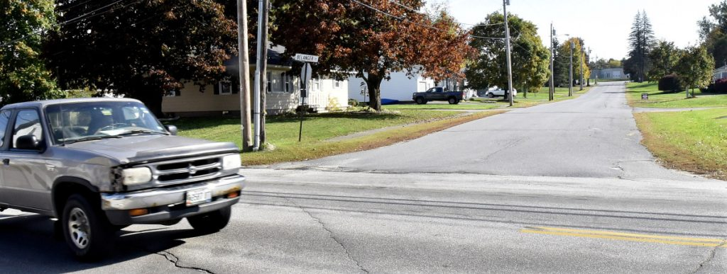 Traffic passes Belanger Street in Winslow at the intersection of the Cushman Road on Wednesday. After complaints from residents, the street may become the third in town to ban heavy tractor-trailer truck traffic after the Town Council took an initial vote Tuesday night.