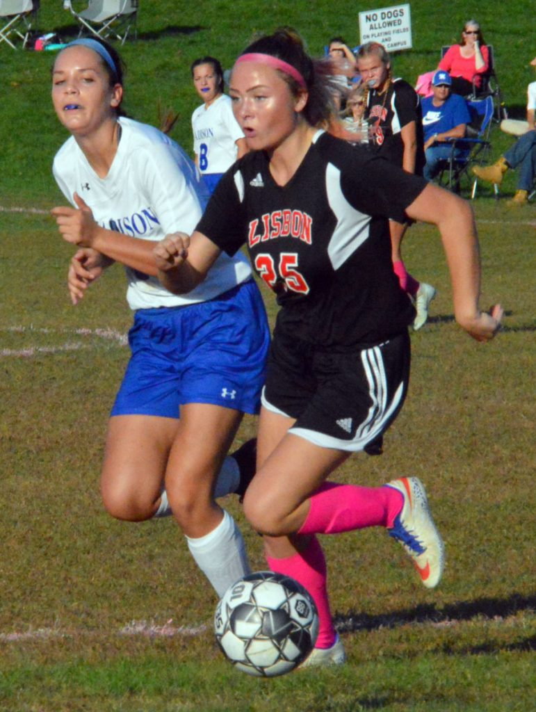 Madison's Grace Linkletter, left, and Lisbon's Caitlyn Hall run side-by-side down the field during Wednesday's MVC girls soccer game in Lisbon.
