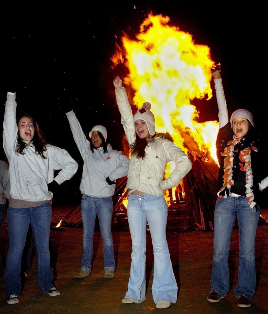 Gardiner cheerleaders do a routine in front of  a giant bonfire on the Gardiner waterfront prior to the 2007 conference championship game against Winslow. It was common for schools to hold big pep rallies prior to big games, including playoff games and the annual Cony-Gardiner showdown.