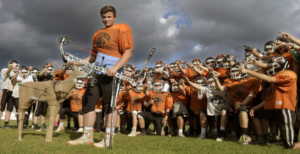 Gardiner lineman Brad Sandelin stands with his team at practice on Wednesday in Gardiner. The varsity football player is also a world champion archer.