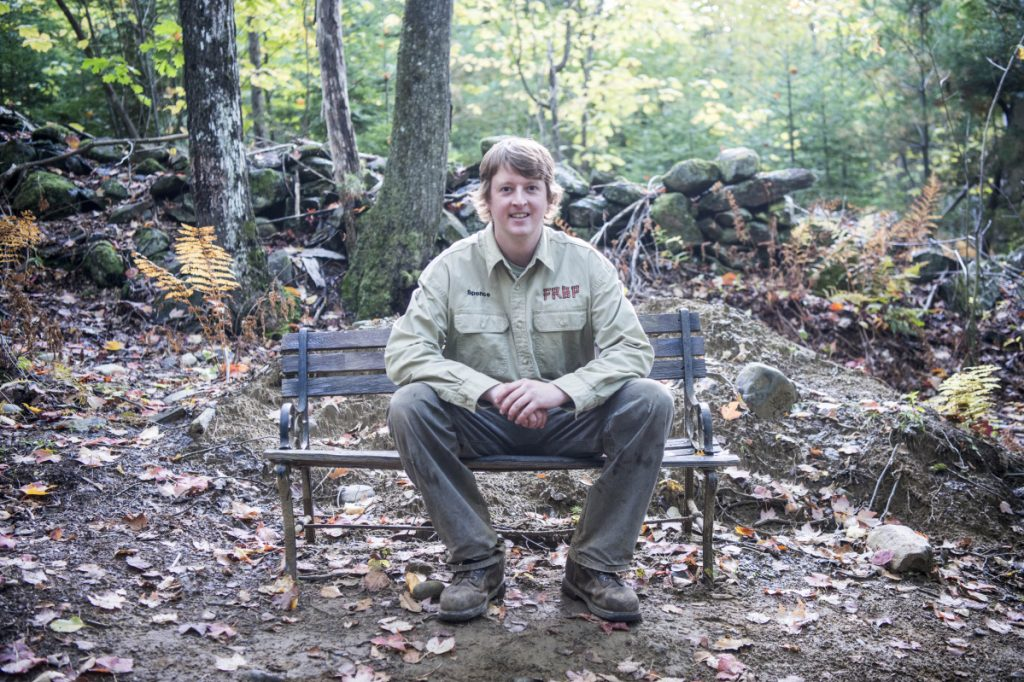 Spencer Lee, owner of Freeman Ridge Bike Park in Freeman Ridge Township, takes a seat Oct. 3 along his network of trails.