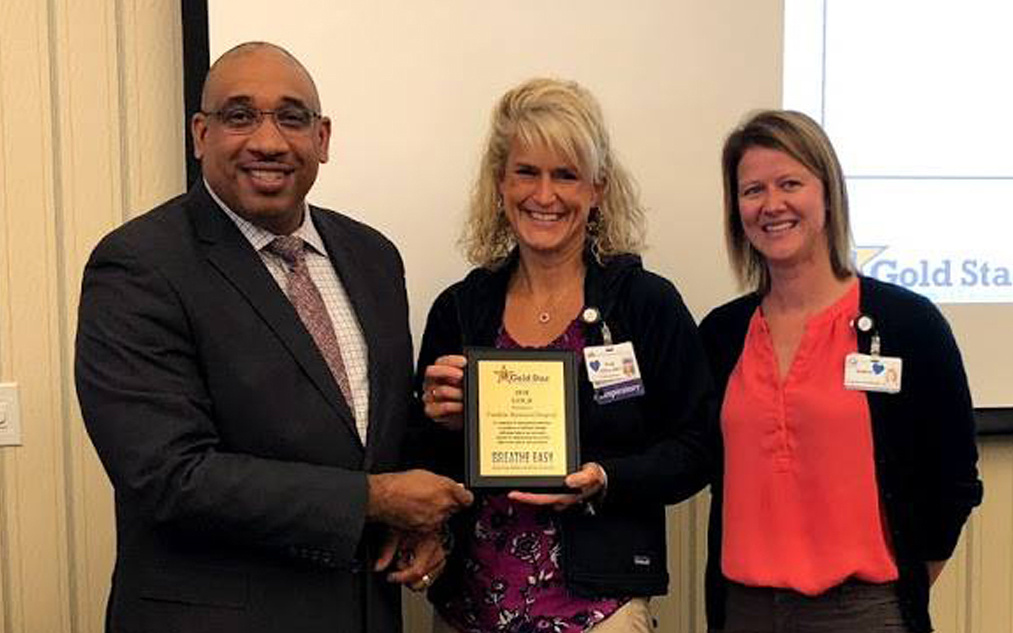From left, Kenneth I. Lewis, senior director of the Center for Tobacco Independence, presents a Tobacco-Free Hospital Gold Star Standards of Excellence Award to Heidi Hilton, of Franklin Memorial Hospital, and Andrea Richards, of the Healthy Community Coalition.