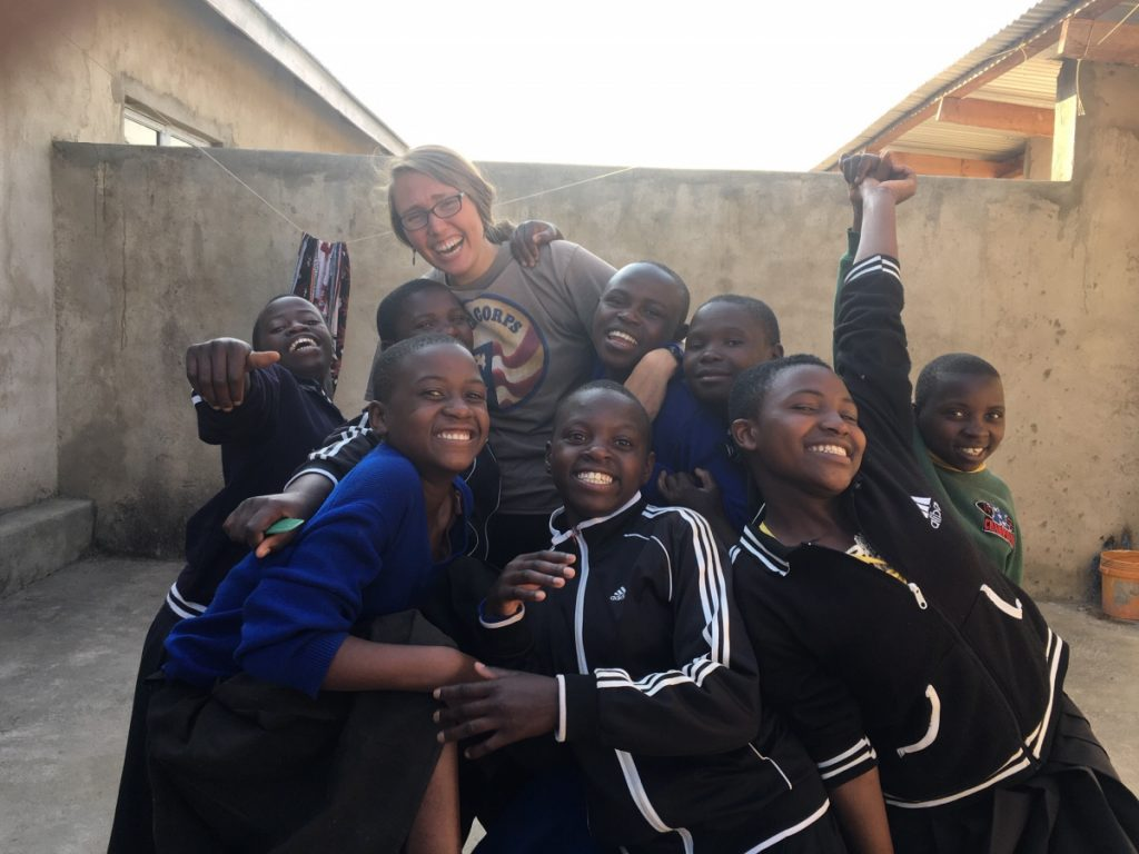 Elizabeth Ferry, of Winslow, is seen working with the Peace Corps in Tanzania.