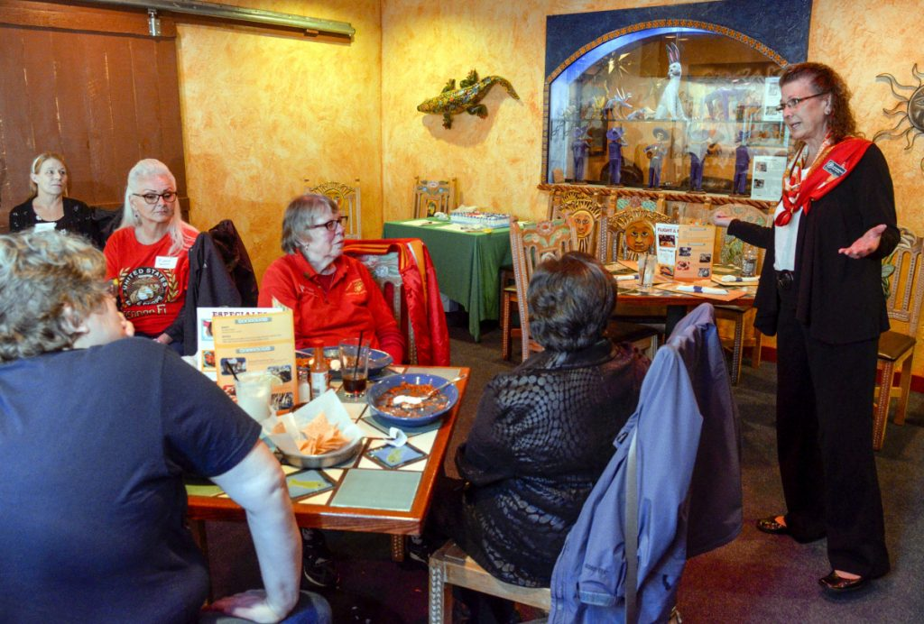 Jamie B. DePaola, Women Marines Association Area 1 director, speaks during a get-together of the group on Saturday at Margarita's in Augusta.