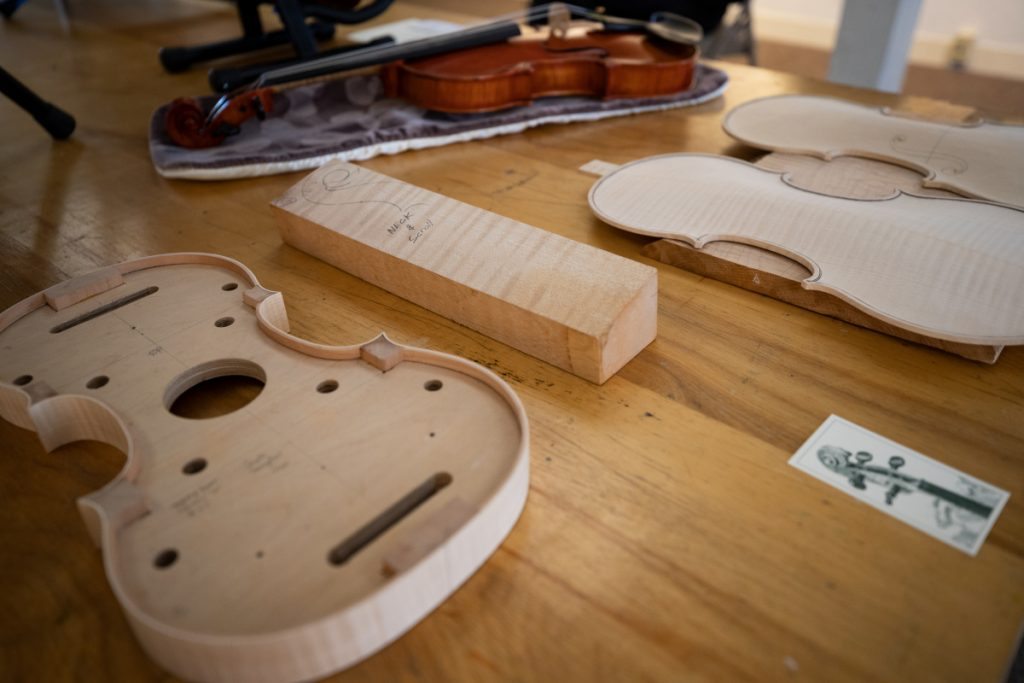 On display on the bottom floor of the Harlow Gallery, a cut away example of a violin sits on a table. Multiple Maine-based luthiers' work was on display from guitars to violins and cellos. The second annual Luthier Exhibition & Music Showcase took place in Hallowell this weekend.