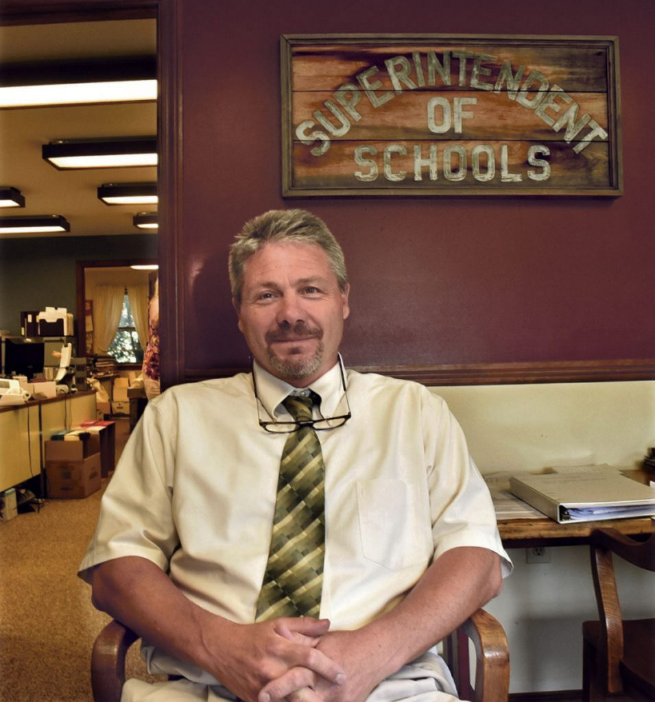 """RSU 19 Superintendent Mike Hammer, in his office in Newport on September 5, said in an email Monday that the district is holding a contest to come up with a """"visual identity"""" logo that is not Native American but will match the """"Warriors"""" nickname."""