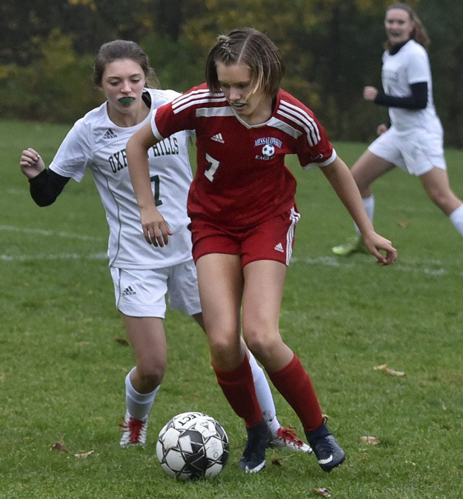 Messalonskee's Cloe Sisson, right, and Oxford Hill's Kaity Montelongo go after the ball during a game Monday in Oakland.
