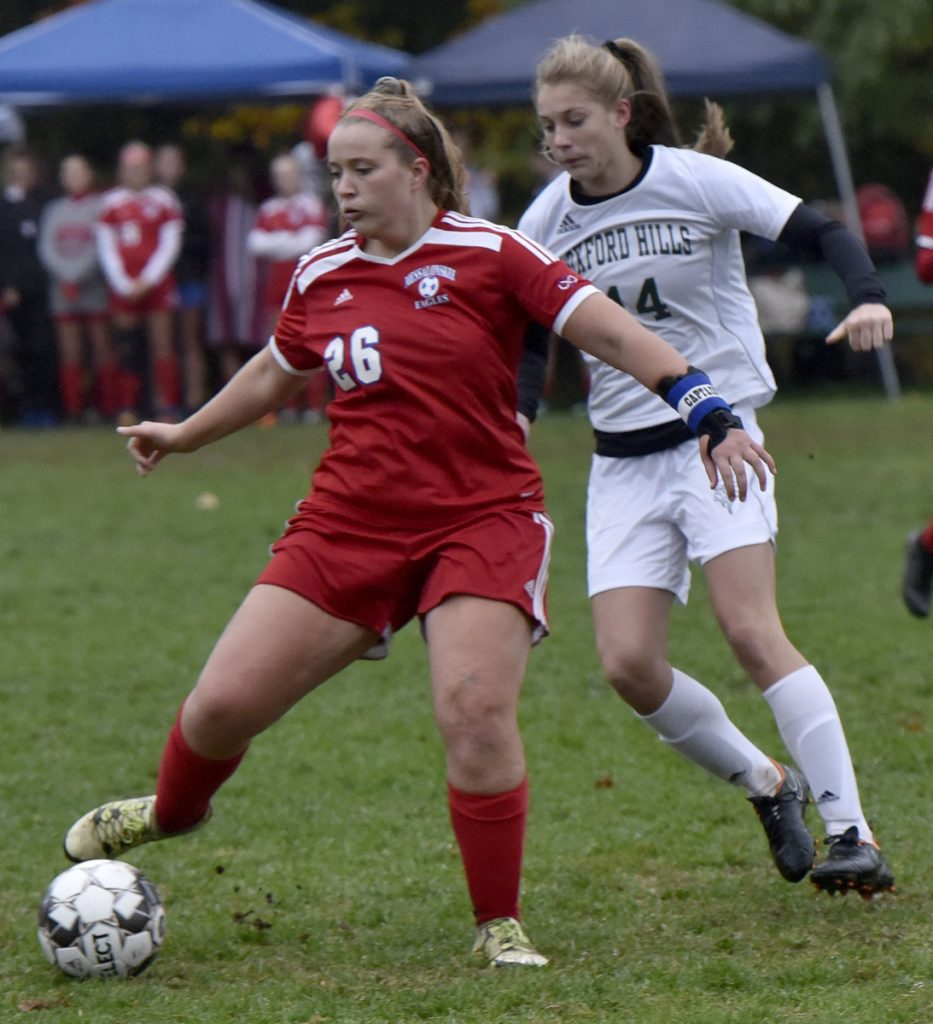 Messalonskee's Grace Bourgoin (26) and Oxford Hill's Ella Kellogg compete during a game Monday in Oakland.
