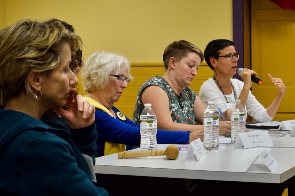 """Eliza Townsend, far right, executive director of The Maine Women's Lobby, makes a point about the plight of Maine women and families who live in poverty during the """"Power of Women in Politics in 2018: Voting, Running, Resisting"""" panel discussion at the LCDC monthly meeting Sept. 26. (From left are Shannon Carr, MD, Molly Cowan, MaryRae Means, Cait Vaughan and Townsend."""