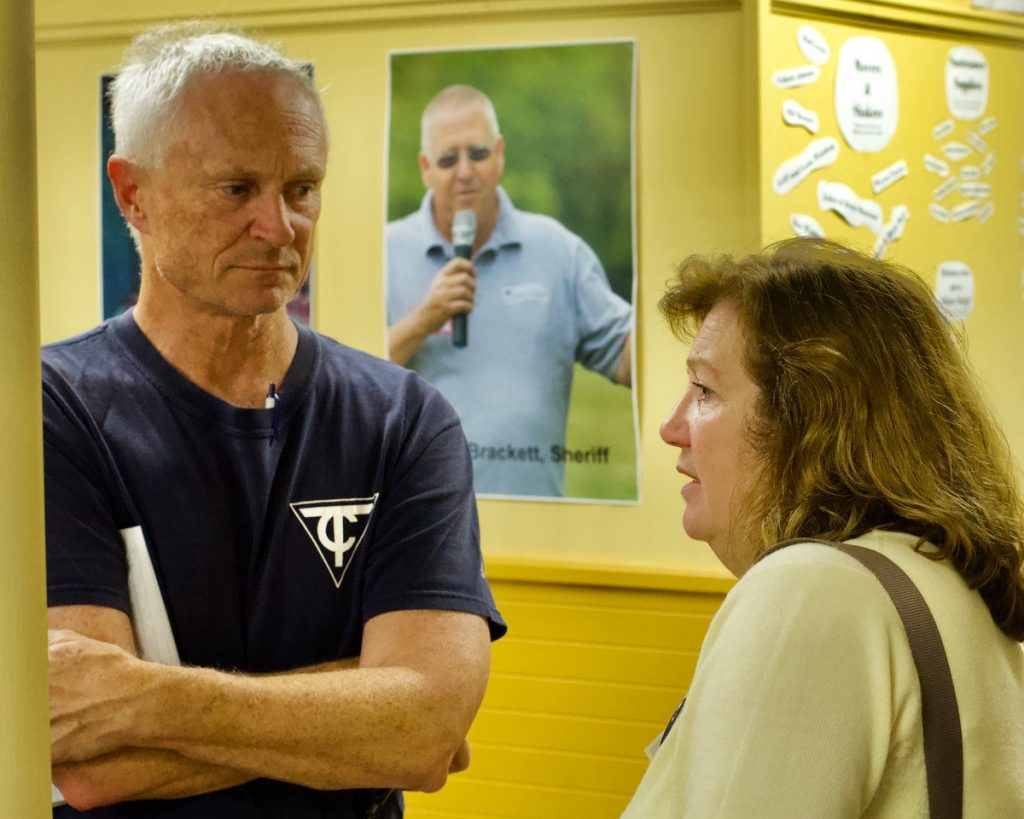 Candidate Laura Fortman, right, speaks with South Bristol resident Geoff Bates's concerns about the future of women's rights in Maine at the conclusion of the Sept. 26 LCDC meeting.