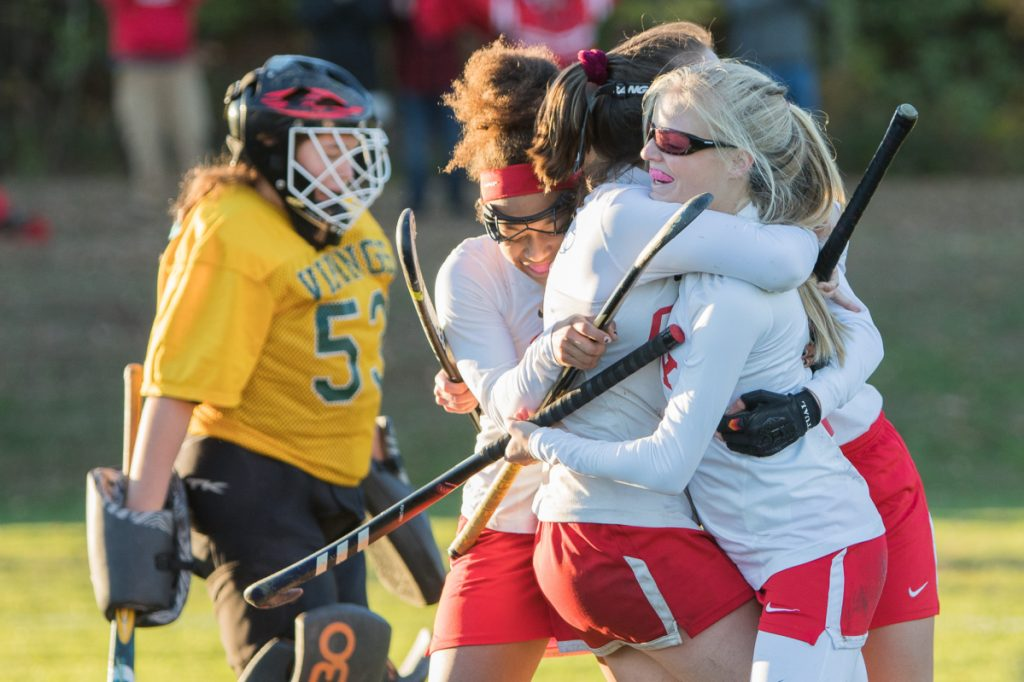 Photo by Jennifer Bechard   Cony's Sophie Whitney, right, celebrates with teammates Anna Stolt, center, Kami Lambert , left, and Julia Reny, back, after scoring the winning goal in overtime in a Class A North quarterfinal game against Oxford Hills onTuesday in Augusta.