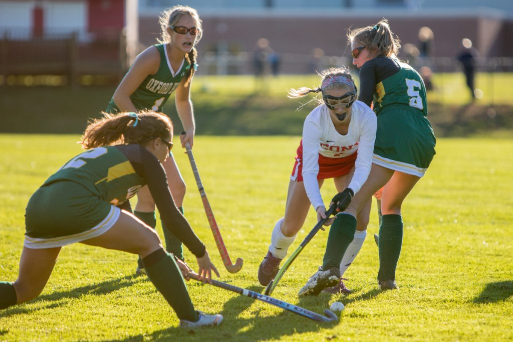 Photo by Jennifer Bechard   Cony's Julia Reny, center, fights for the ball while being defended by Oxford Hills' Lauren Merrill, right, and Kate Bowen, left, in a Class A North quarterfinal game Tuesday in Augusta.