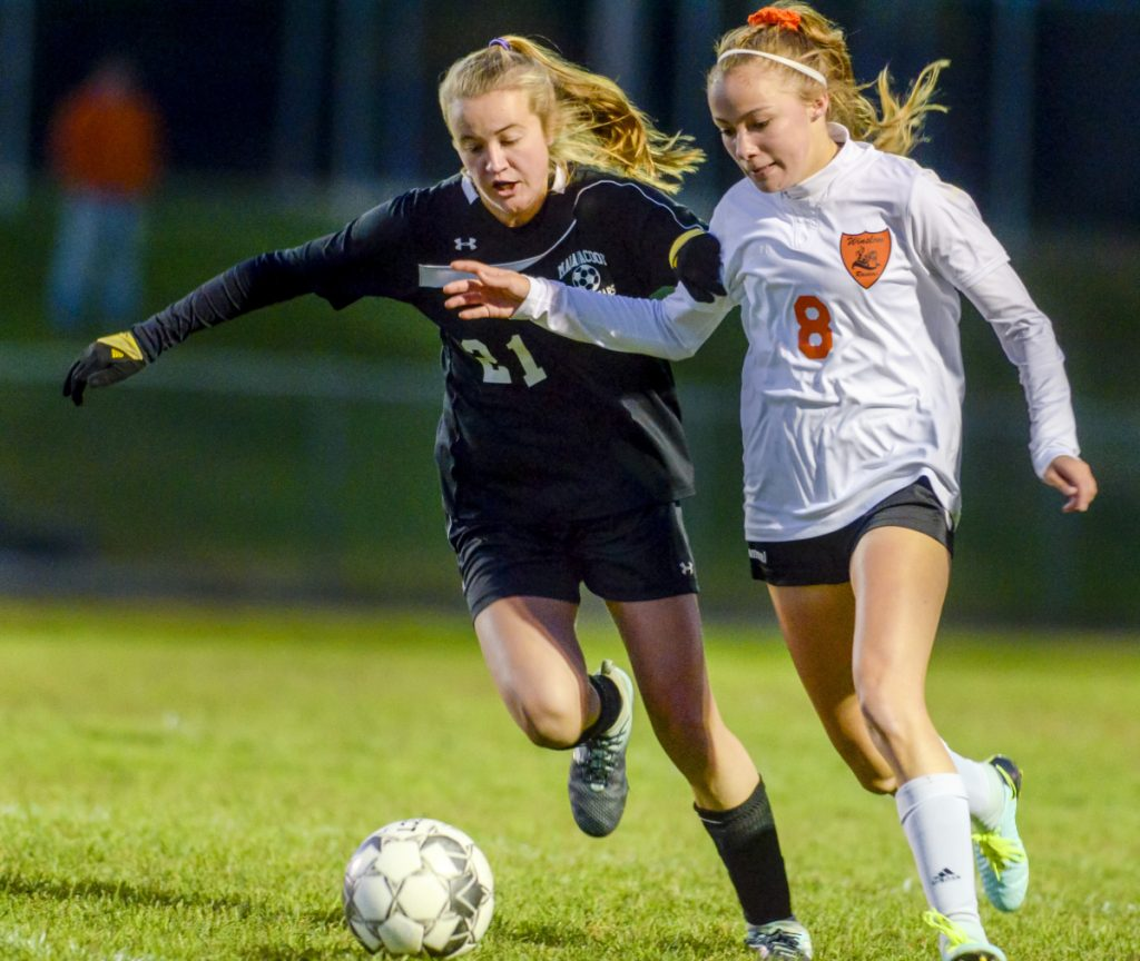 Maranacook's Grace Dwyer, left, and Winslow's Katie Doughty battle for a ball during a game Tuesday in Readfield.