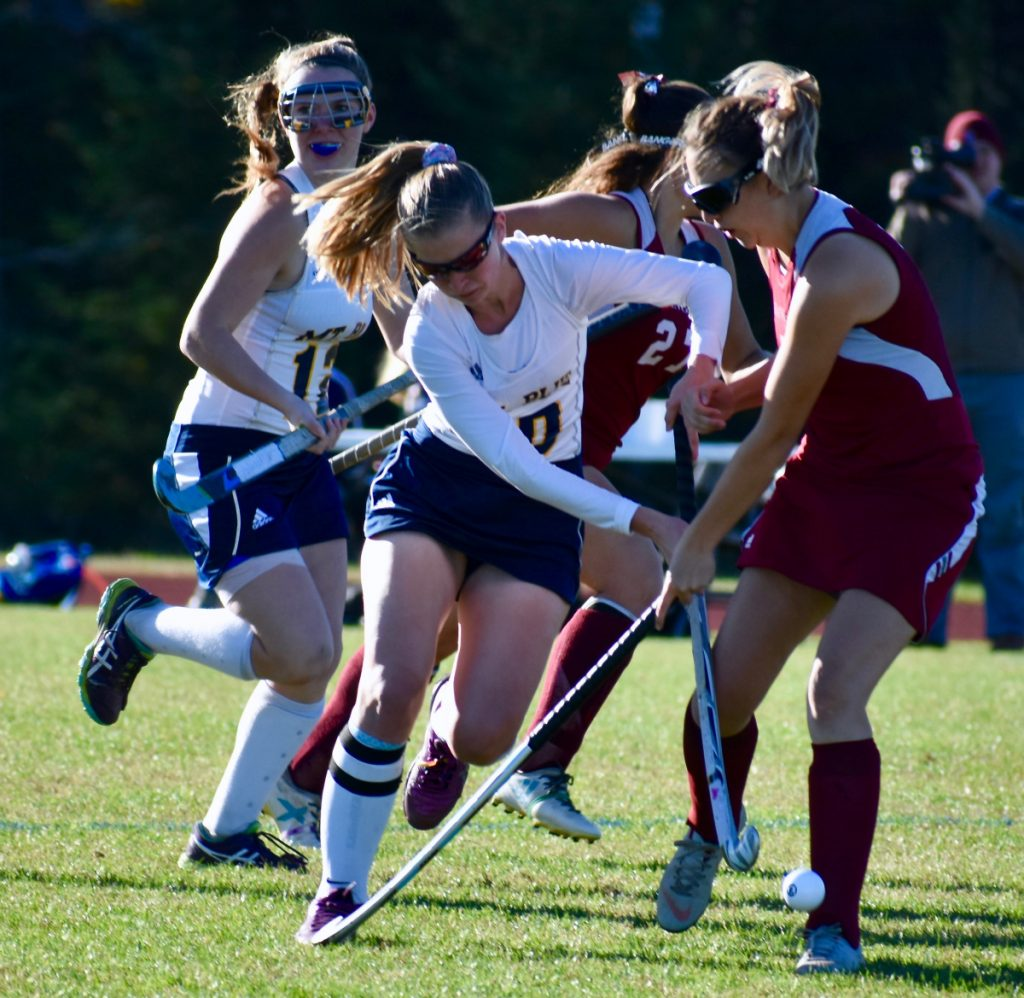 Mt. Blue senior forward Ellie Pelletier (10) and Bangor midfielder Makenzie Thompson (7) battle for the ball in a Class A North field hockey quarterfinal at Caldwell Field in Farmington on Tuesday afternoon.