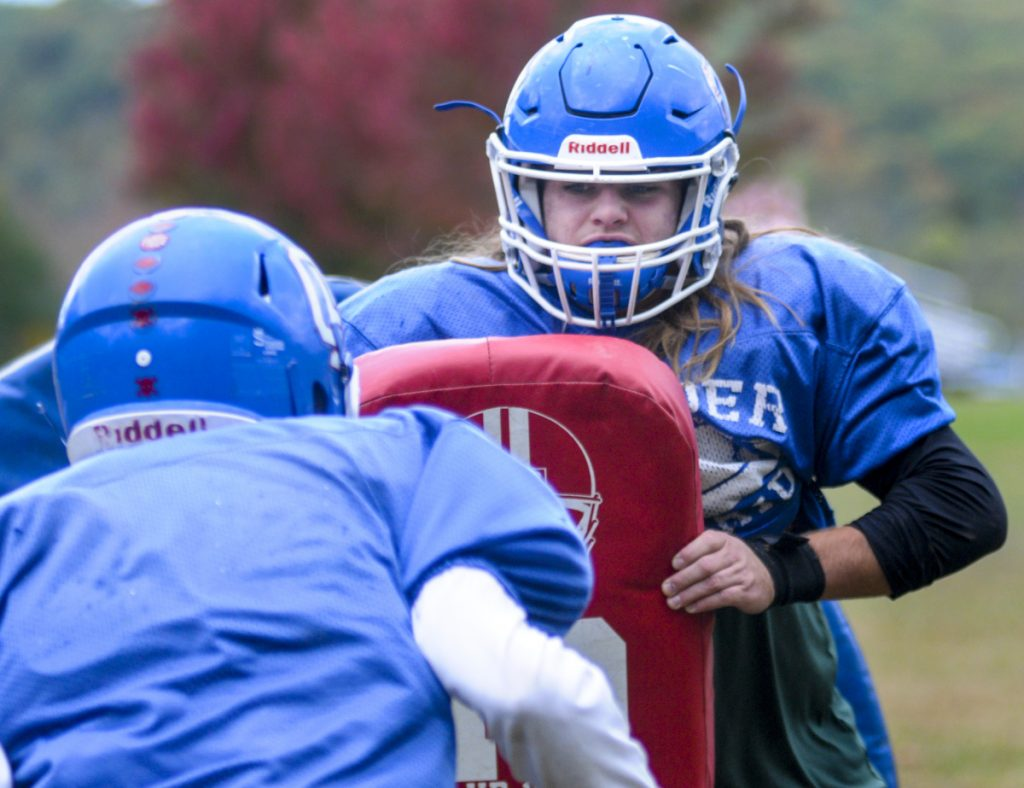 Oak Hill linebacker Ethan Richard works through a drill during practice Wednesday in Wales.