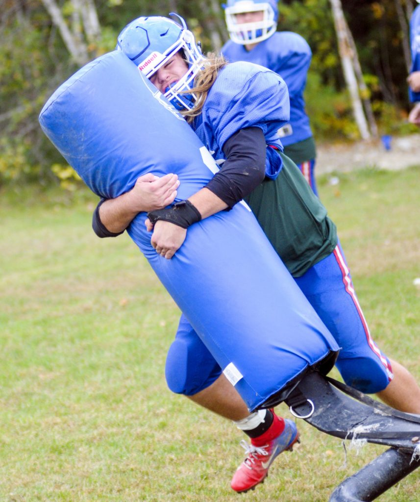 Oak Hill linebacker Ethan Richard wraps up a bag during practice Wednesday in Wales.