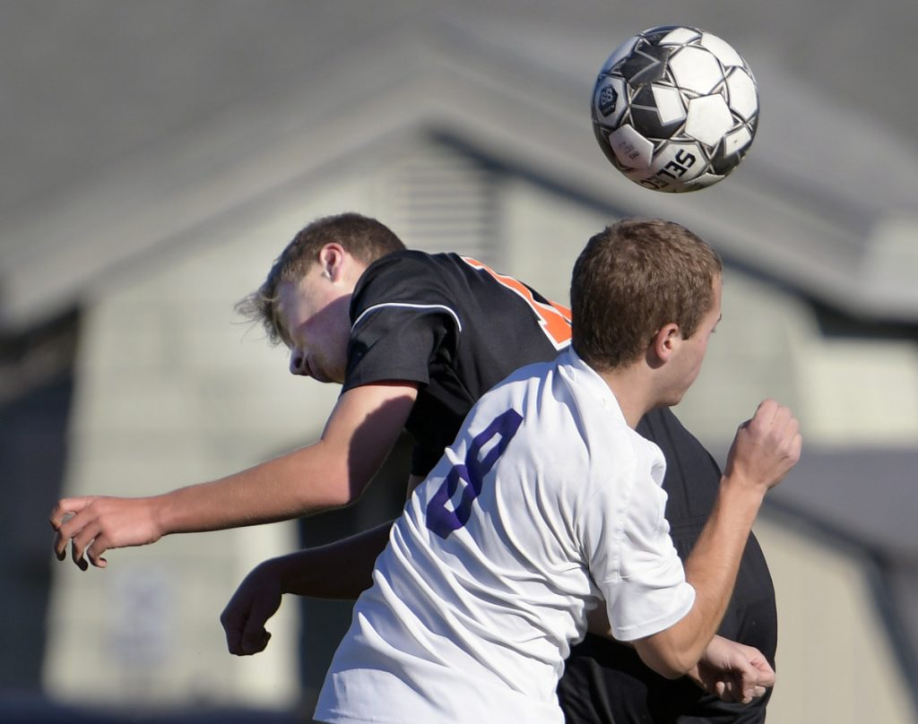Gardiner's Isaac Gammon, back, and Alec Gagnon of John Bapst battle for the ball during a Class B North prelim game Friday in Gardiner.