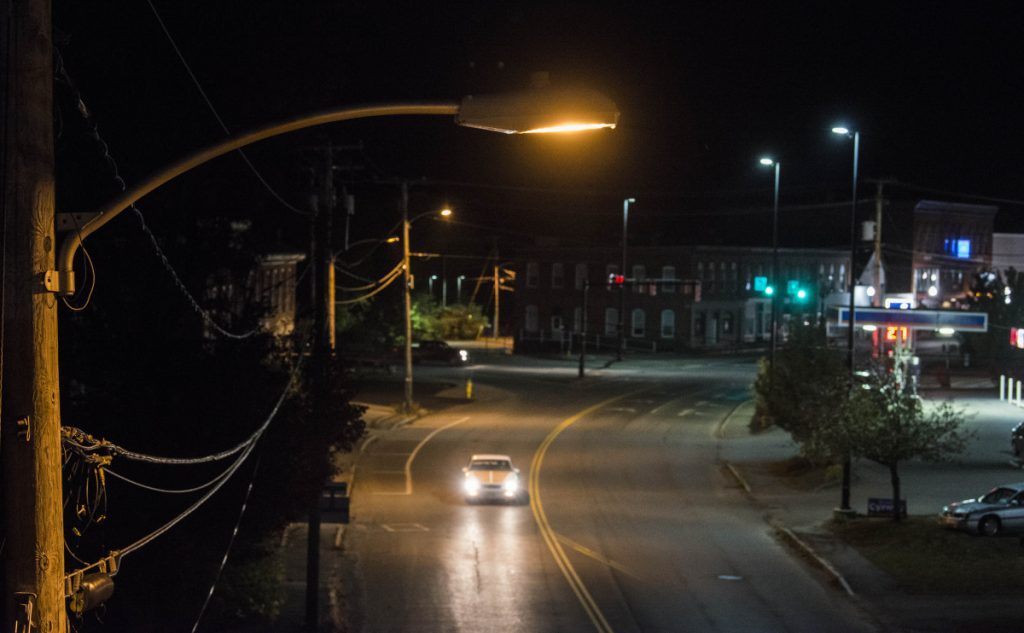 A lone street light illuminates Upper Main Street next to the train overpass in Fairfield on Friday night.