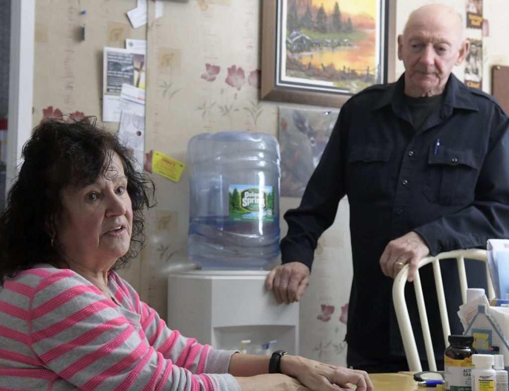 Gene and Cathy Burgess at their home in Belgrade on Friday. Homeowners around Belgrade's Cemetery Road, Routes 11 and 27 triangle seeing high levels of salt in their wells. DOT is currently providing bottled water to them while seeking a long-term solution.
