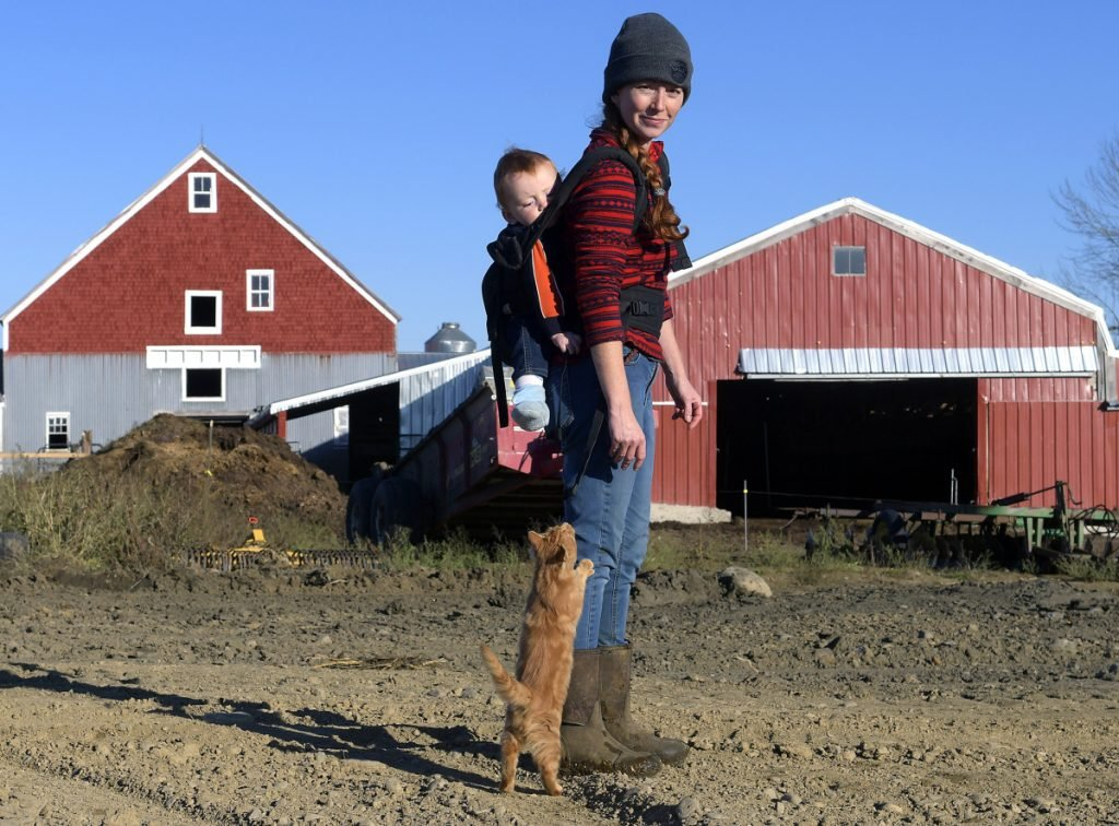 Alexis MacDonald and her son, Rory, on the site of the pad of the future composting operation at her family's Washington farm on Friday. Bo Lait Farm received a Department of Environmental Protection grant last month to start the composting businesses. Bo Lait Farm is teaming with another composting company to help divide the work load.