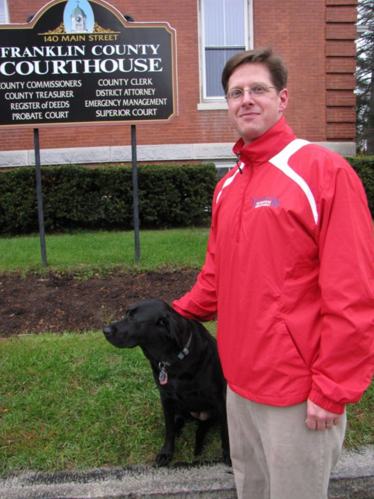 Andrew Robinson with his dog Buttercup in front of the Franklin County Courthouse.