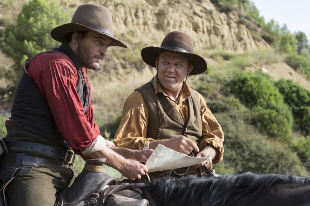 "Joaquin Phoenix, left, stars as Charlie Sisters and John C. Reilly, right stars as Eli Sisters in Jacques Audiard's ""The Sisters Brothers,""an Annapurna Pictures release."
