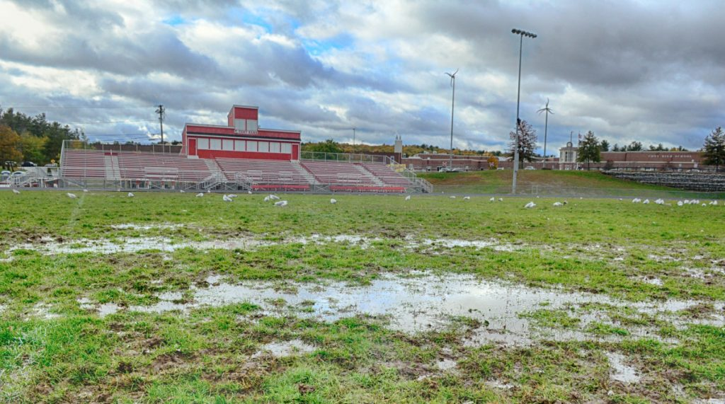 Water puddles dot the muddy surface of Alumni Field at Cony High School. The school announced Wednesday that it will play its Pine Tree Conference Class B semifinal game Nov. 2 at Lewiston High School because Alumni Field isn't suitable to host a game.