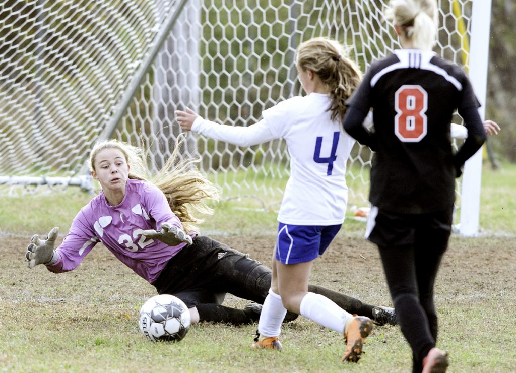 Lisbon goalie Sarah Haggerty jumps on a shot by Mt. Abram's Kaylee Knight during the second half of a Class C South quarterfinal game Wednesday in Lisbon. Haggerty made the save.