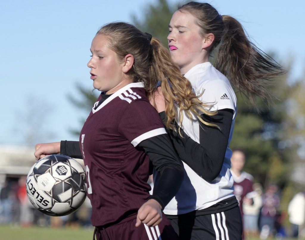 Richmond's Bry Shea, left, blocks a shot as she's defended by Buckfield's Kylie Carrier during a Class D South semifinal game Friday in Richmond.