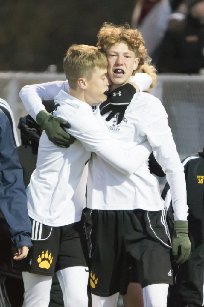 Maranacook players richard Down, right, and Aric Belanger celebrate after the Black Bears beat Hall-Dale in penalty kicks in a Class C South semifinal game Friday in Lewiston.