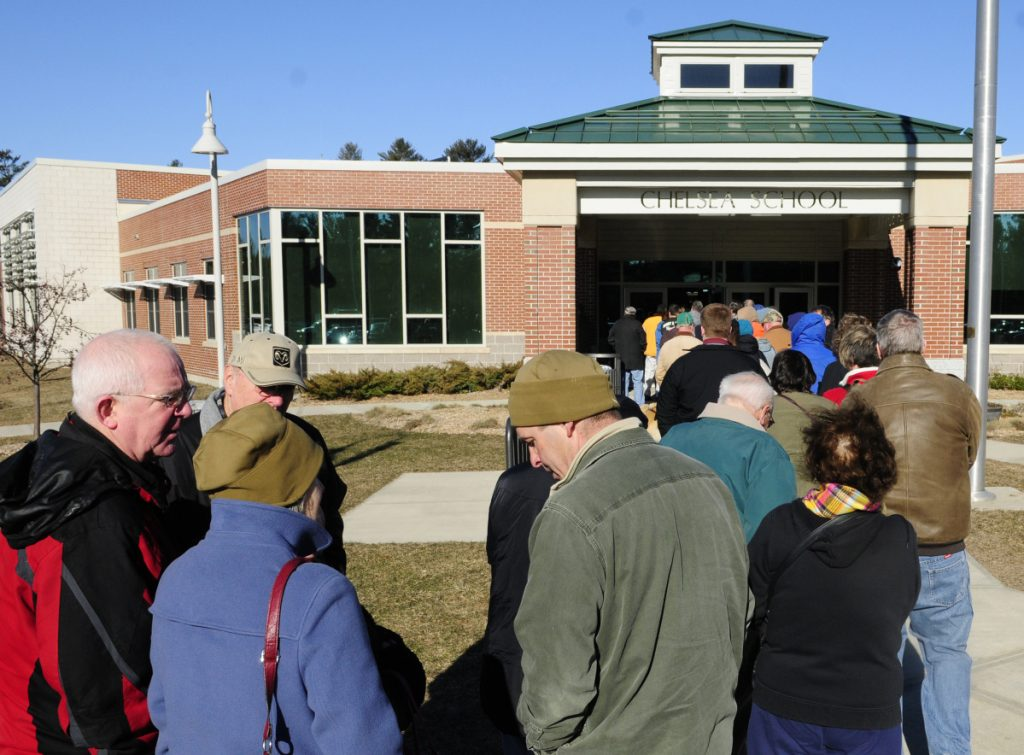 Lines stretched outside to check in and vote during Kennebec County Republican caucus on March 5, 2016, at Chelsea School.