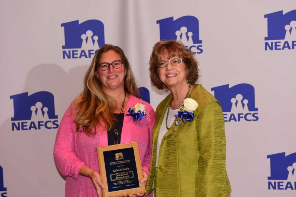 University of Maine Cooperative Extension educator Kathy Savoie, left, recently was presented with the Distinguished Service Award by Lora Lee Frazier Howard, National Extension Association of Family and Consumer Sciences board president.