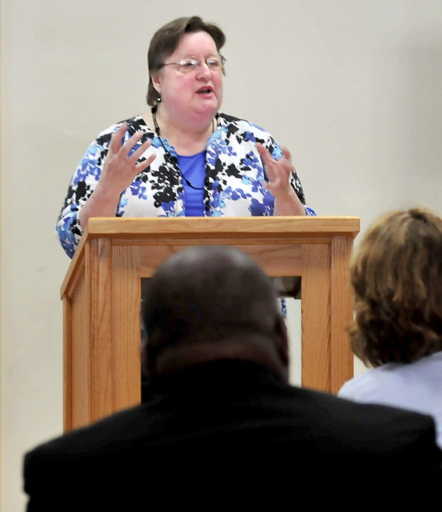 Betty Palmer, executive director of the Mid-Maine Homeless Shelter in Waterville, speaks about the issue of youth homelessness that the organization has seen firsthand during a forum on the subject on April 30, 2014.