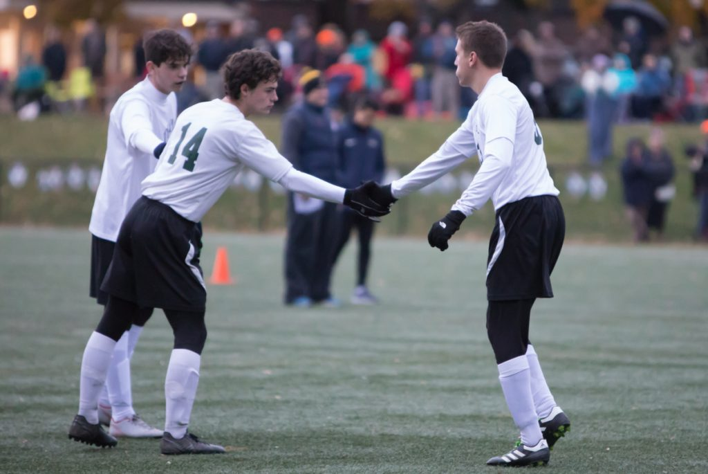 Photo by Jennifer Bechard Temple's Noah Shepherd (14) shakes Ilija Ivkovic's hand after Ivkovic makes his penalty kick in the Class D South final against North Yarmouth Academy Wednesday.