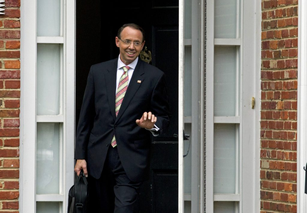 Deputy Attorney General Rod Rosenstein leaves his home on Thursday in Bethesda, Maryland. His meeting with President Trump has been postponed until next week.