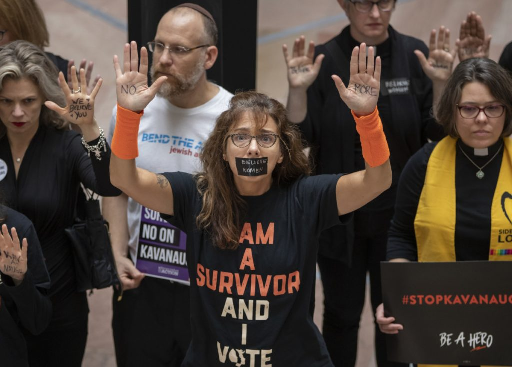 Protesters demonstrate at the Hart Senate Office Building in Washington, D.C., on Thursday, decrying Brett Kavanaugh's Supreme Court nomination.