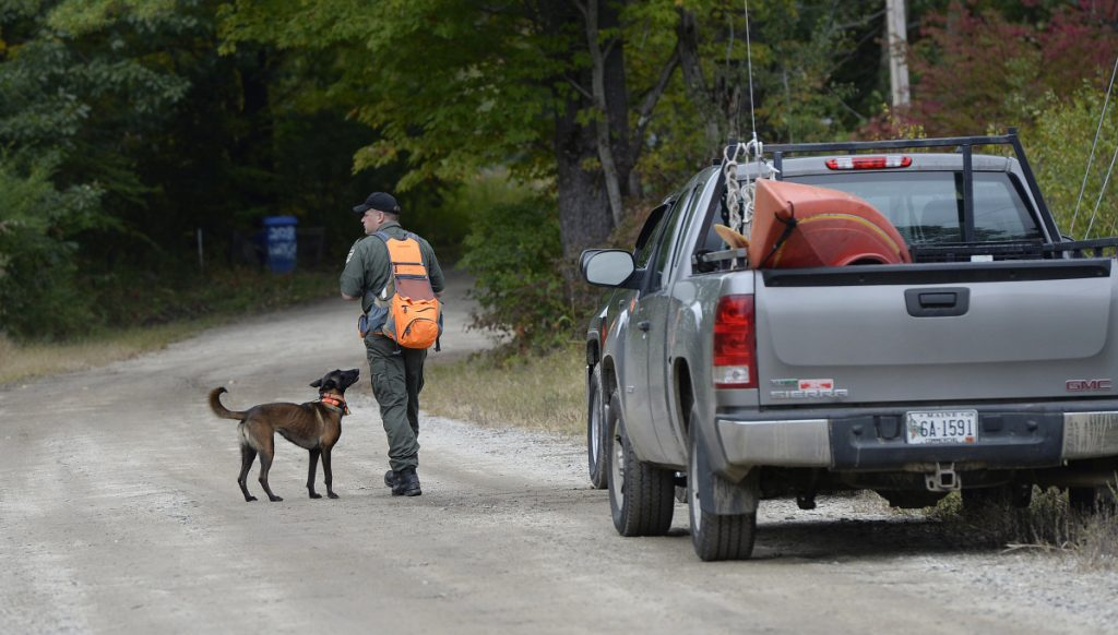 Game Warden Jeremy Judd prepares to go out into the woods with a search dog Thursday to look for Kristin Westra of North Yarmouth who has been missing since Sunday night.