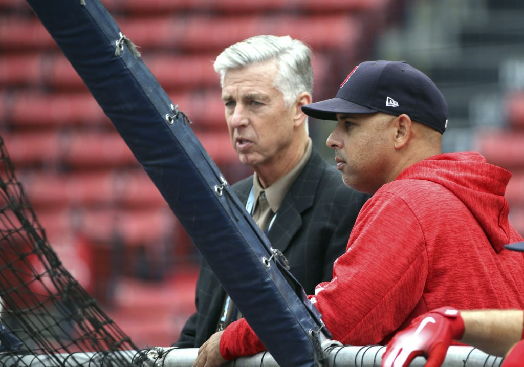 Boston Red Sox President of Baseball Operations Dave Dombrowski, left, and Red Sox Manager Alex Cora watch Thursday's workout at Fenway Park.