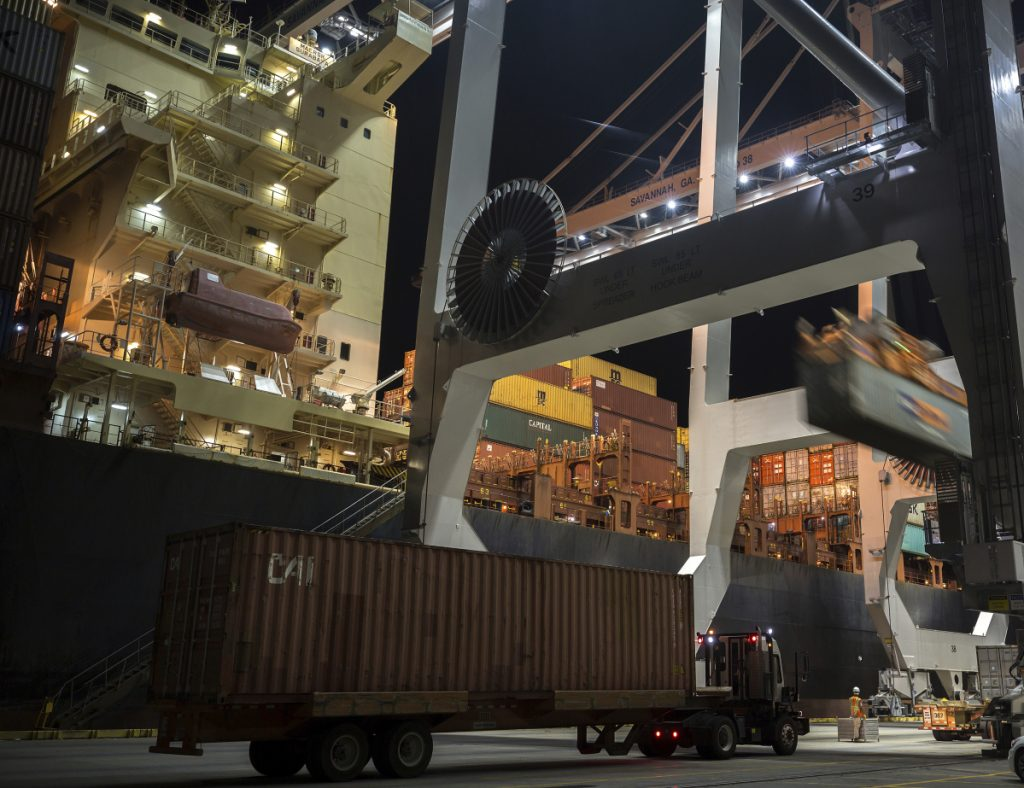 A crane loads a 40-foot shipping container onto a ship at the Port of Savannah in Georgia in July.
