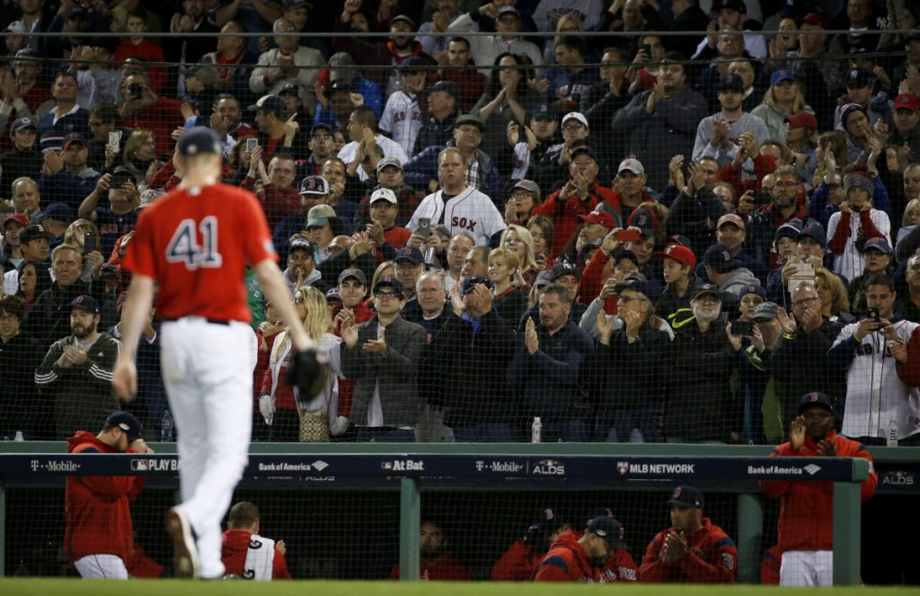 Fans cheers as Boston Red Sox starting pitcher Chris Sale leaves the baseball game against the New York Yankees during the sixth inning of Game 1 of an American League Division Series on Friday at Fenway Park. (AP Photo/Elise Amendola)