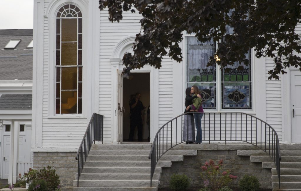Two women hug outside of the Congregational Church in Cumberland before attending a prayer vigil for Kristin Westra on Saturday.