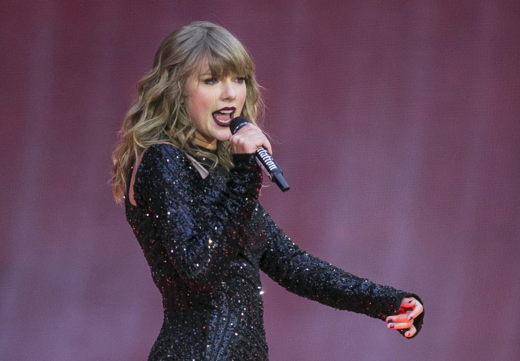 Singer Taylor Swift performs on stage in concert at Wembley Stadium in London. Swift posted on Instagram Sunday that she's voting for Tennessee's Democratic Senate candidate Phil Bredesen, breaking her long-standing refusal to discuss anything political.