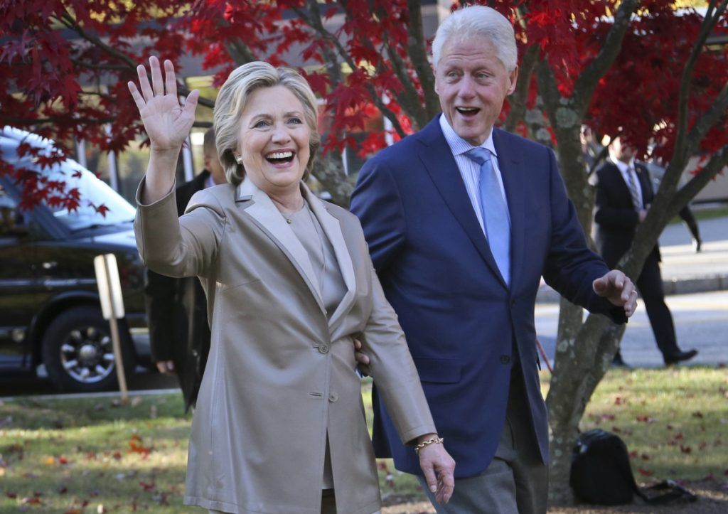 Hillary Clinton and her husband, former President Bill Clinton, greet supporters after voting in Chappaqua, N.Y., on Nov. 8, 2016.