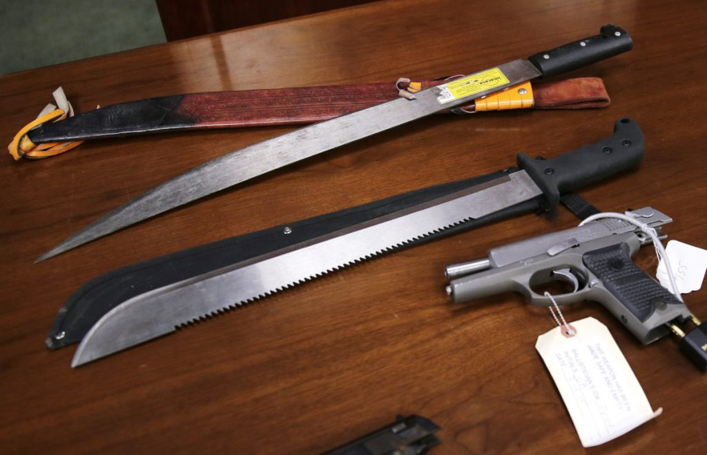 Weapons are displayed at the U.S. Attorney's Office following the January 2016 arrests of dozens of MS-13 gang members in Boston.