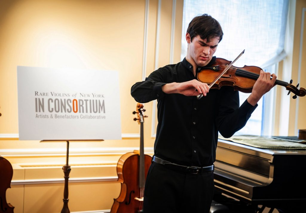 """Juilliard student Nathan Meltzer, seen here with the """"Ames"""" Stradivari of 1734. The instrument used to belong to Roman Totenberg before it was stolen."""