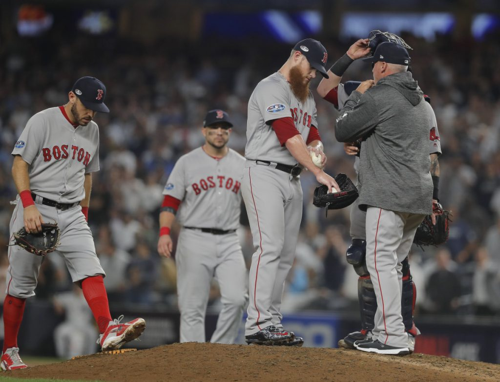 Boston Red Sox relief pitcher Craig Kimbrel talks with pitching coach Dana LeVangie during the ninth inning Tuesday night at Yankee Stadium in New York. (AP Photo/Julie Jacobson)